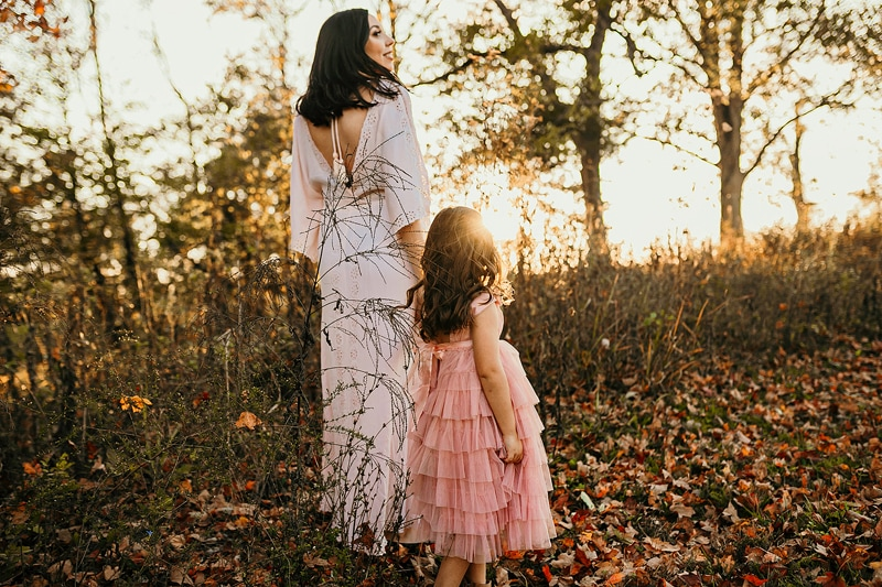 Portrait Studio in Louisville KY, mother and daughter walking hand in hand during sunset