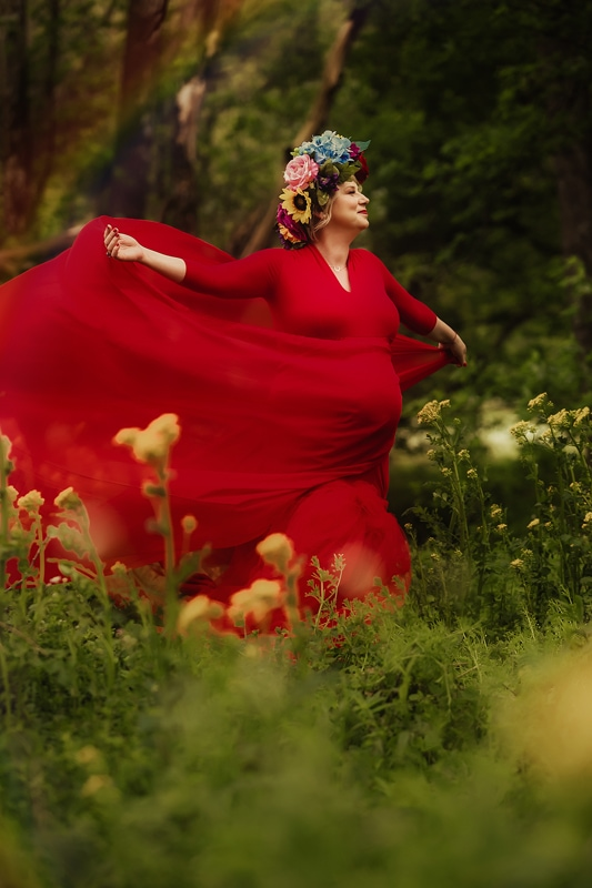 Portrait Studio in Louisville KY, pregnant woman in long red dress and flower crown