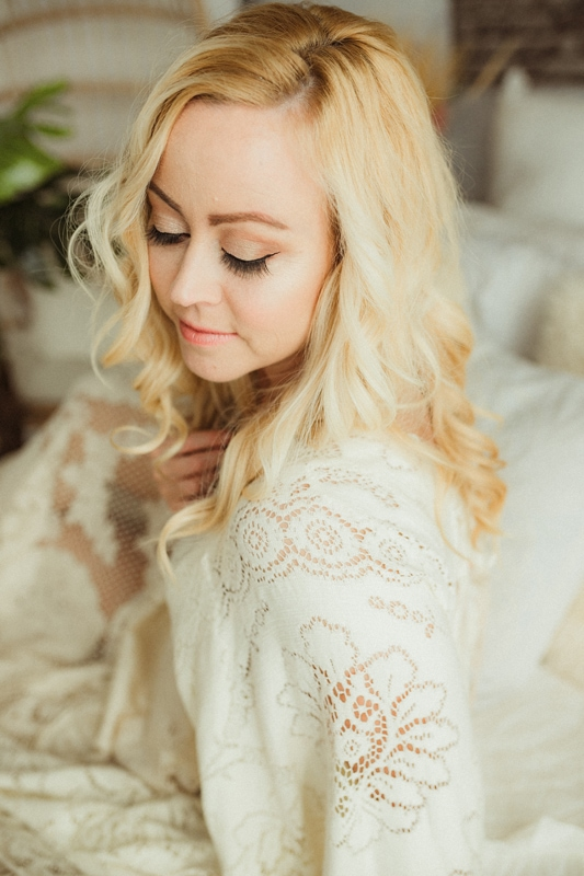 Portrait Studio in Louisville KY, woman sitting up in bed with lace dress
