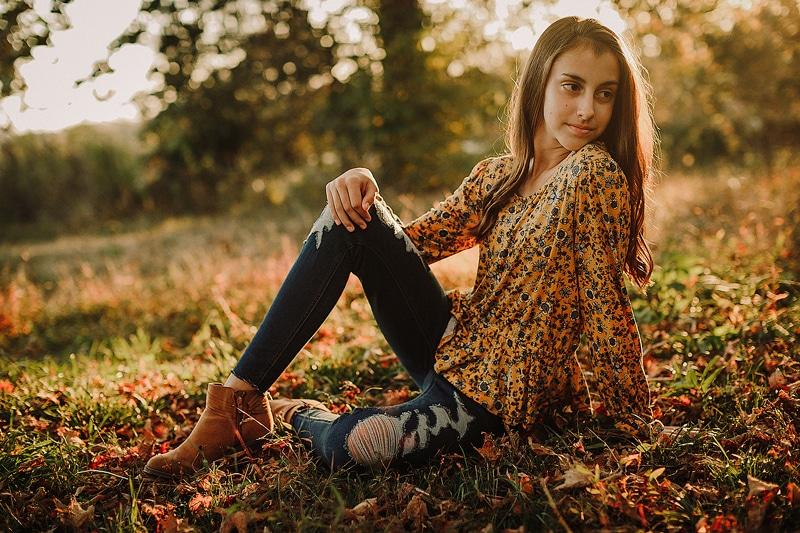 Portrait Studio in Louisville KY, teen girl sitting in grass under a tree