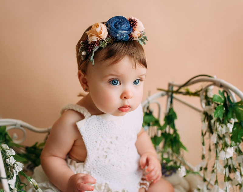 Portrait Studio in Louisville KY, baby girl posing with big floral headband on