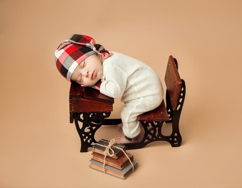 Portrait Studio in Louisville KY, baby asleep on a miniature desk