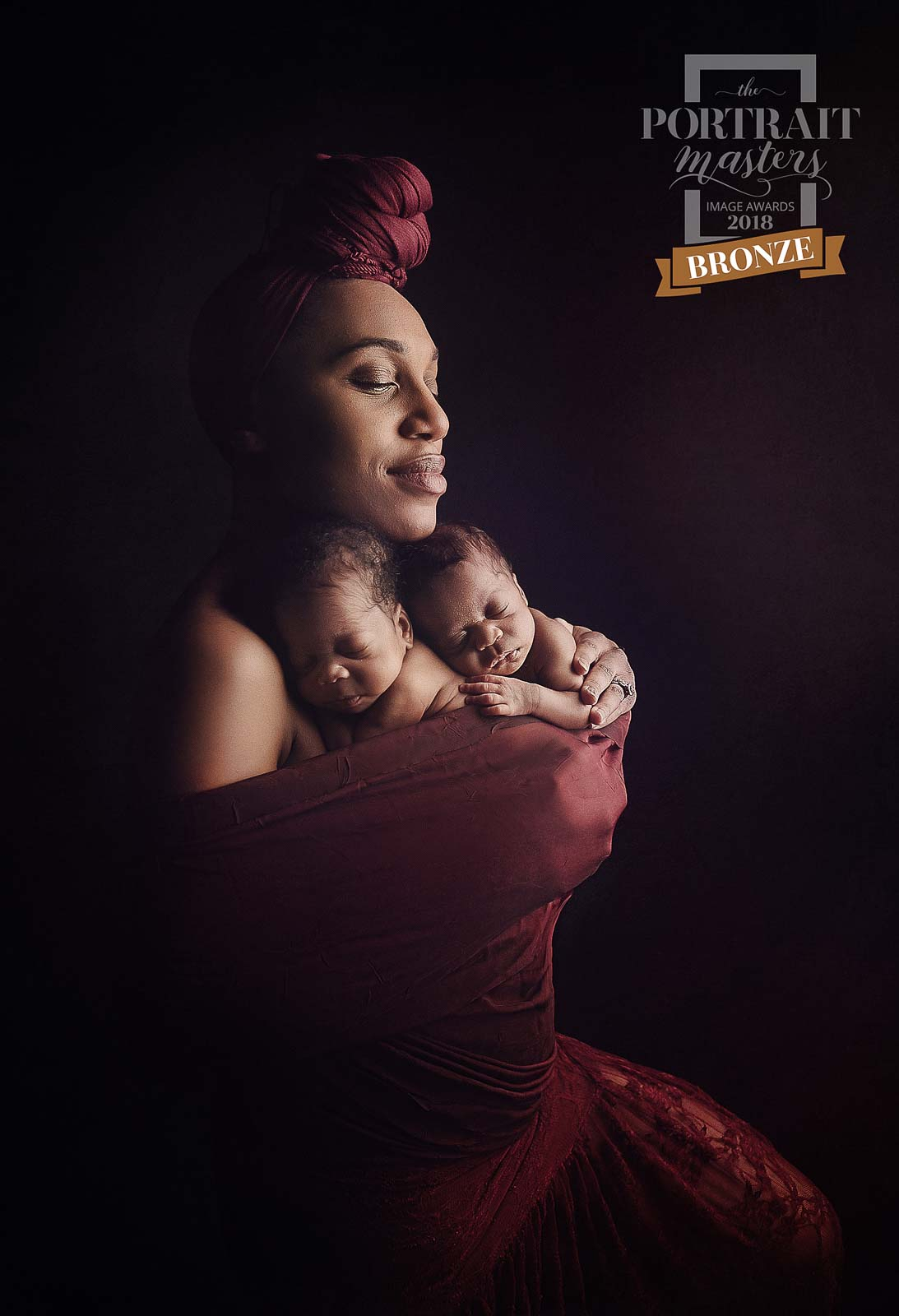 Louisville Maternity Photographer, woman with her baby wrapped up around her chest