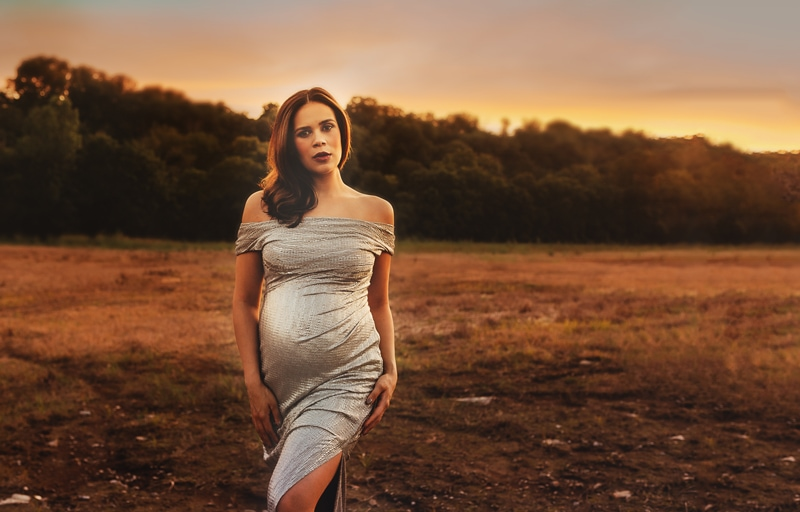 Louisville Maternity Photographer, woman standing in field wearing a shimmering dress